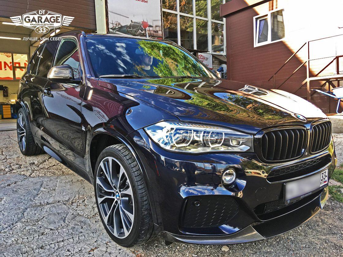 На фото BMW X5 черного цвета после полировки с защитой в мастерской «DT GARAGE 33» - г.Владимир.