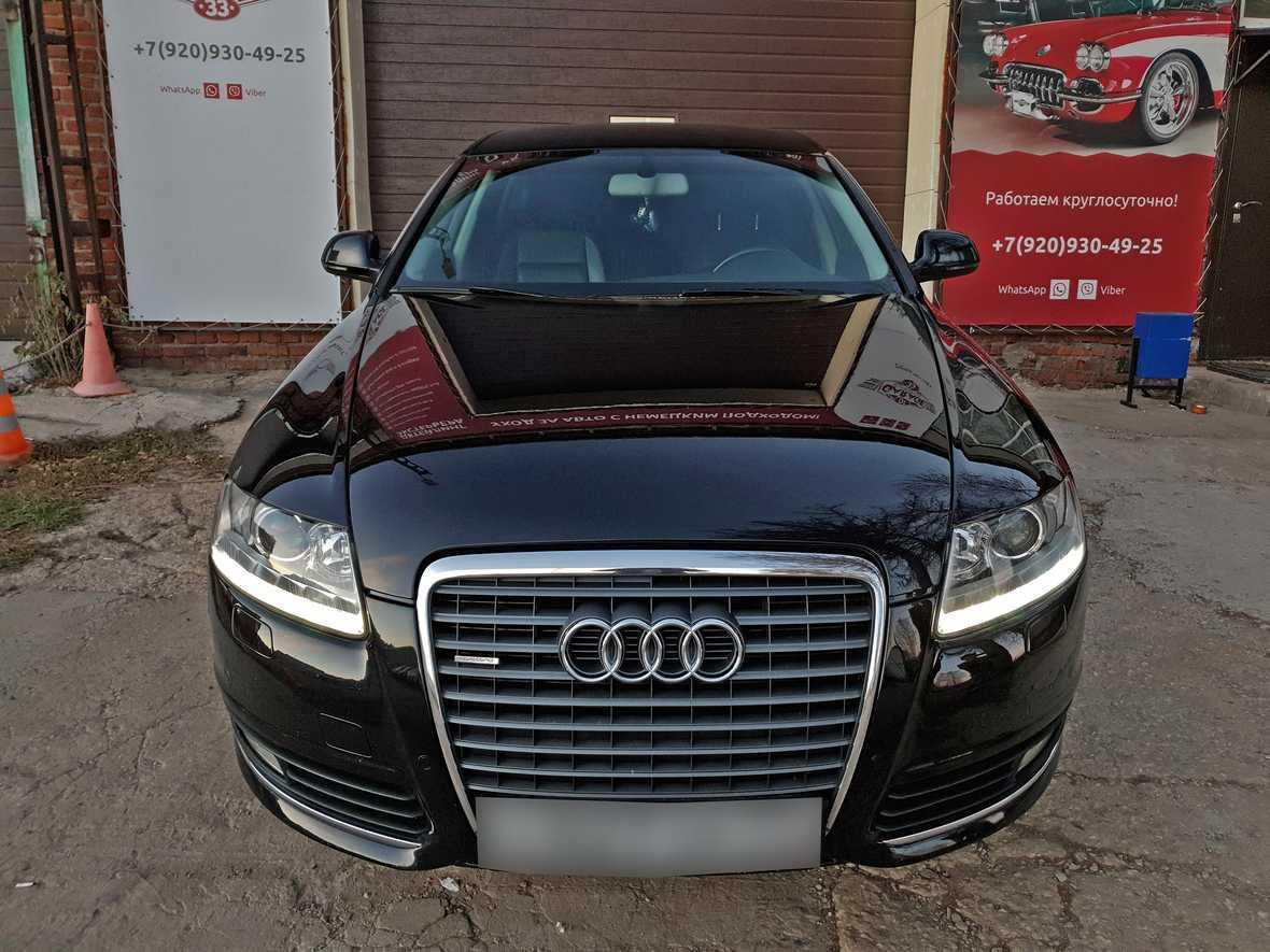 На фото капот автомобиля Audi A6, обработанный керамикой 9H+.